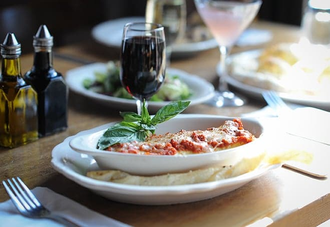 Italian meal with a red glass of wine at Fondi Pizzeria in Gig Harbor, WA